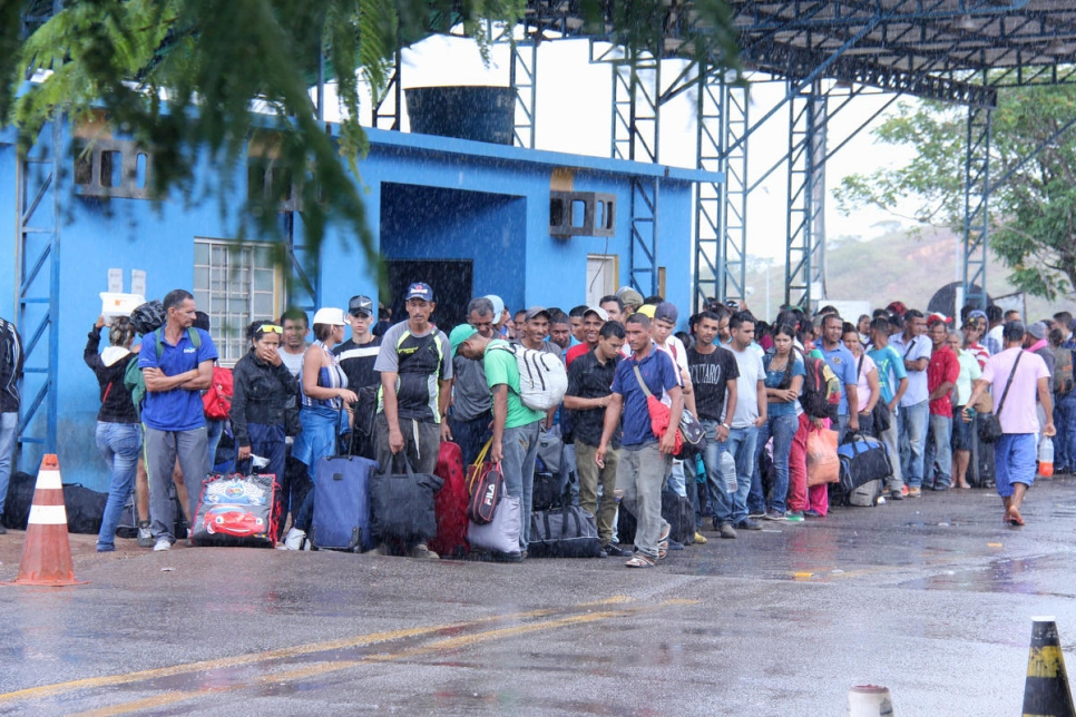 Venezuelans wait at the Federal Police station at the border town of Pacaraima, in the state of Roraima.